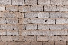 Brick wall as background with slag. Photo of an abstract texture Royalty Free Stock Image
