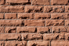 Brick Wall Background. Textured Red Brick Wall Background Side lit Royalty Free Stock Photo