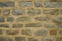 Brick wall background. Textured background of different shaded bricks in wall Stock Image