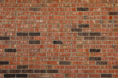 Brick Wall Background. A photo of a red and black brick wall taken in a horizontal format which can be used for a background Stock Photos