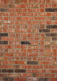 Brick Wall Background. A photo of a red and black brick wall taken in a vertical format which can be used for a background Stock Images