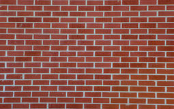 Brick Wall Background. A photo of a red brick wall taken in a horizontal format which can be used for a background Stock Photography