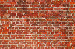 Brick Wall Background. Old repaired weathered brick wall for background Stock Photos