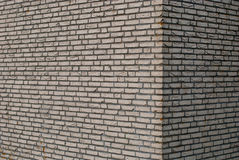 Brick wall background. Abstract brick wall background showing corner of modern building Stock Photos