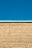 Brick wall background. Against blue sky royalty free stock images
