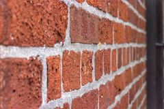 Brick wall background at angle. Perspective of a red brick wall pattern from a skewed view Stock Photography