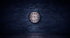 New Year`s Hours. Round wooden clock on the old brick wall, bokeh effect, celebratory, magic light, New Year, Christmas. Brick wall background, antique clock royalty free stock photography