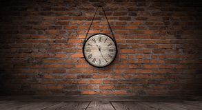 New Year`s Hours. Round wooden clock on the old brick wall, bokeh effect, celebratory, magic light, New Year, Christmas. Brick wall background, antique clock royalty free stock photos