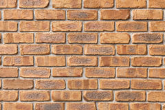 Brick wall background. The wall of the brown tile Royalty Free Stock Image