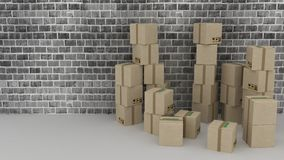 Brick wall background with cardboard boxes Stock Images