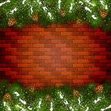 Brick wall background with Christmas fir tree branches and snow Stock Photos
