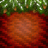 Brick wall background with Christmas fir tree branches Royalty Free Stock Photography