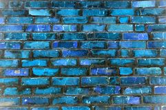 Brick wall background with colored bricks
