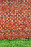 Brick wall background with grass Royalty Free Stock Photography