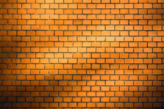 Brick wall background with natural shadow vignette. Orange brick wall background with natural shadow vignette Royalty Free Stock Image
