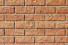 Brick wall background with dark orange royalty free stock images