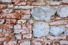 Outdoor texture, red bricks and white stones. stock photography