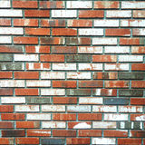 Brick wall background. A wall with brick with pattern of some painted to different colors stock photo