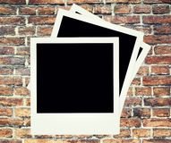 Brick wall background with polaroid Royalty Free Stock Photo