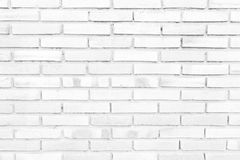 Brick wall background in rural room,. Abstract weathered texture stained old stucco light gray and aged paint white brick wall background in rural room, grungy royalty free stock photos