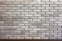 Brick wall background texture with brown trim Royalty Free Stock Photography
