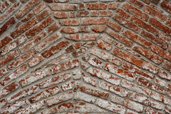 Brick wall background texture meeting of arches Royalty Free Stock Images