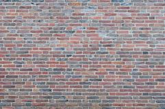 Brick wall. Background with textured effect from a red brick wall Stock Images