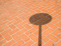 Brick wall background textured with shadow of traffic sign Royalty Free Stock Photography