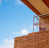 Brick wall balcony with clothes line. And blue sky stock photos