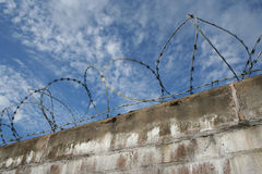 Brick wall with barbed wire stock photo