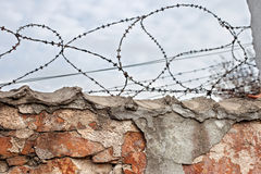 Brick wall with barbed-wire Royalty Free Stock Images