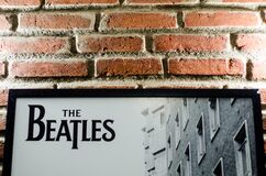 Brick wall with Beatles poster