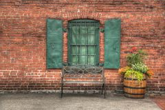 Brick wall and bench Stock Images