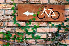 Brick wall with bicycle plate Stock Photo