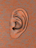 Brick wall with big ear Stock Photo