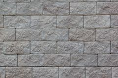 Brick wall with big gray bricks. Used as a background. Copy space for your text royalty free stock photography