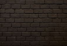 Brick wall black color paint rough surface material pattern block background. Wallpaper royalty free stock image
