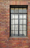 Brick wall black rimmed window Stock Image