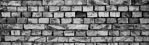 Brick wall. Black and white photography of brick wall built with mud Royalty Free Stock Photo