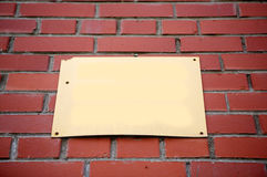 Brick wall with blank sign Royalty Free Stock Images