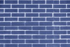 Brick wall blue color. Bright geometric texture. royalty free stock photography