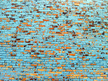 Brick wall with blue paint chipped off. A lite blue painted brick wall with paont falling off Royalty Free Stock Photos