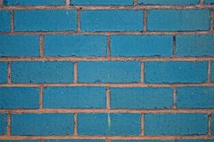 Brick wall. Blue shabby brick on the city street Royalty Free Stock Photography