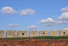 Brick wall and blue sky. Blue cloudy sky and ,view from old castle Royalty Free Stock Photography