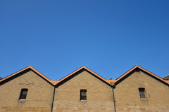 Brick wall with blue sky Stock Photography