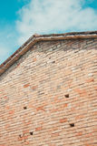 Brick wall and blue sky. Brick wall and a blue sky Stock Photography