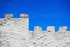 Brick wall and blue sky Royalty Free Stock Image
