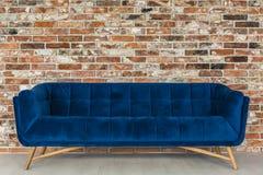 Brick wall and blue sofa royalty free stock photos