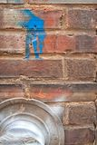 Brick wall with blue paint royalty free stock photography