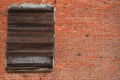 Brick Wall Boarded window Stock Images